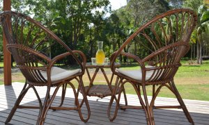 Deck chairs with views to the paddocks and tropical gardens.