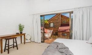 Mango Tree - Byron Bay - Bedroom through to balcony