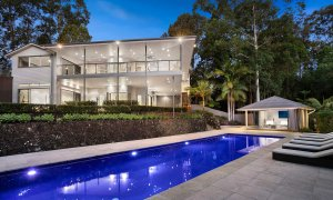 Paperbark - Byron Bay - Front of House with Pool and Poolhouse Dusk Closeup Pool
