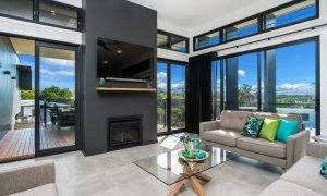 Wollumbin Haus - Byron Bay - lounge area and fireplace