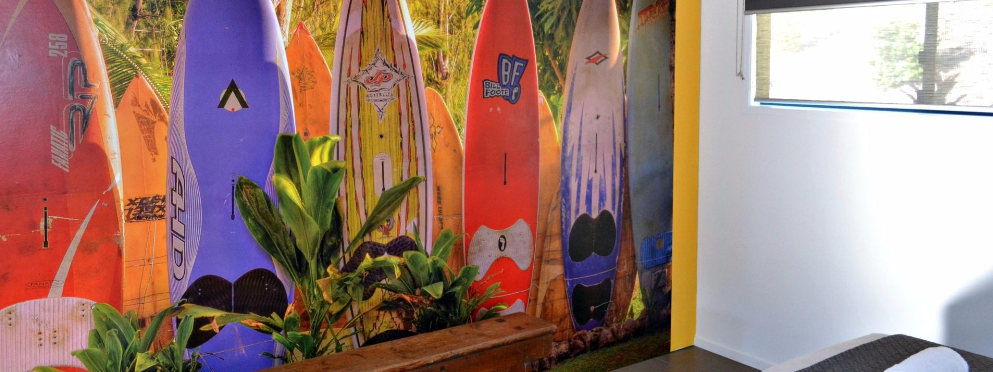 The Retreat pavilion features a giant surf mural opposite the 2 King Single beds.