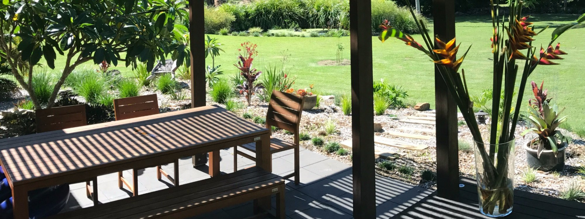 Shaded outdoor dining is located adjacent to the BBQ area and overlooks the water lily pond.