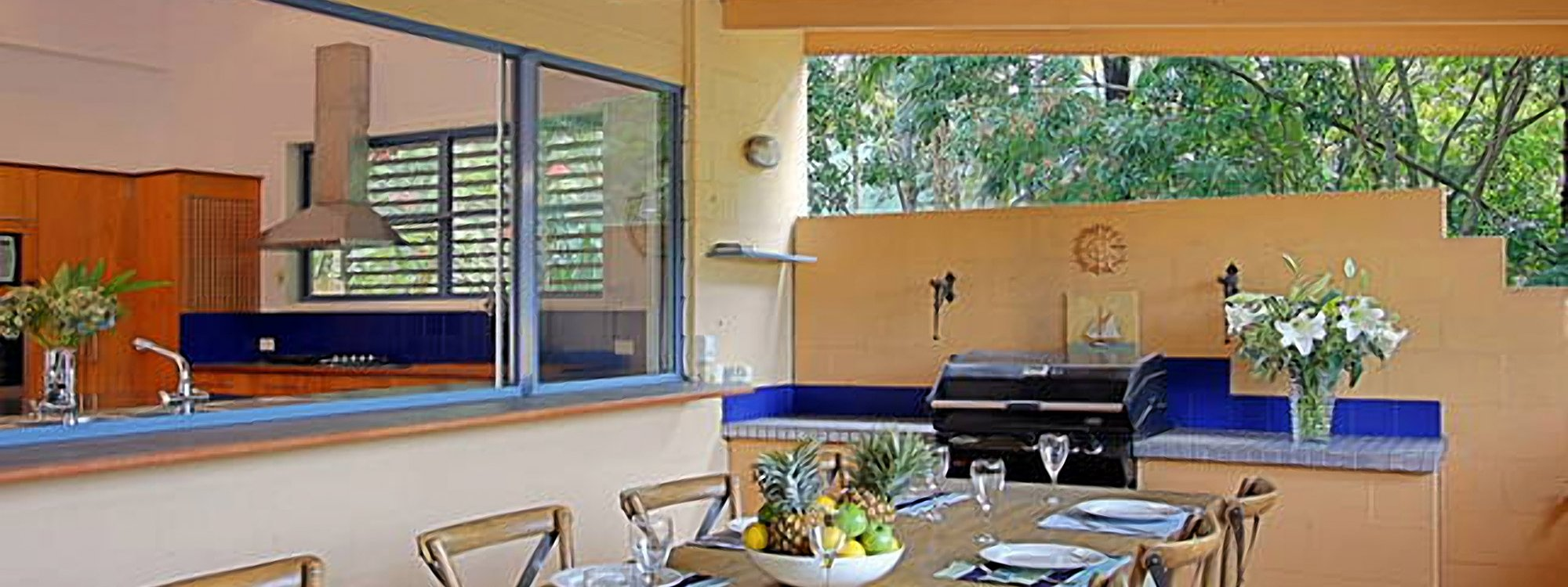 Aurora Byron Bay - Outdoor dining and BBQ area into kitchen