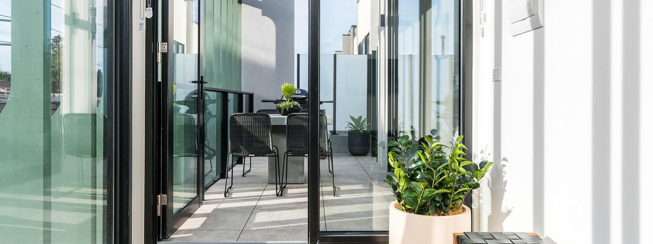 Axel Apartments - The Clarke - Glen Iris - Living towards Balcony b
