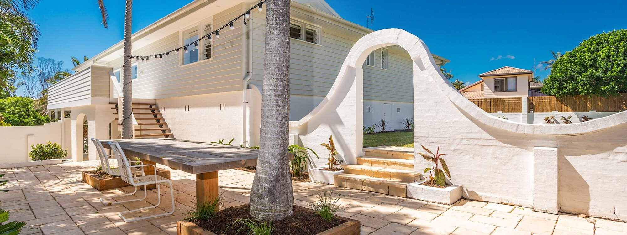 Castaway on Tallows - Byron Bay - Outdoor Courtyard Looking to Rear of House