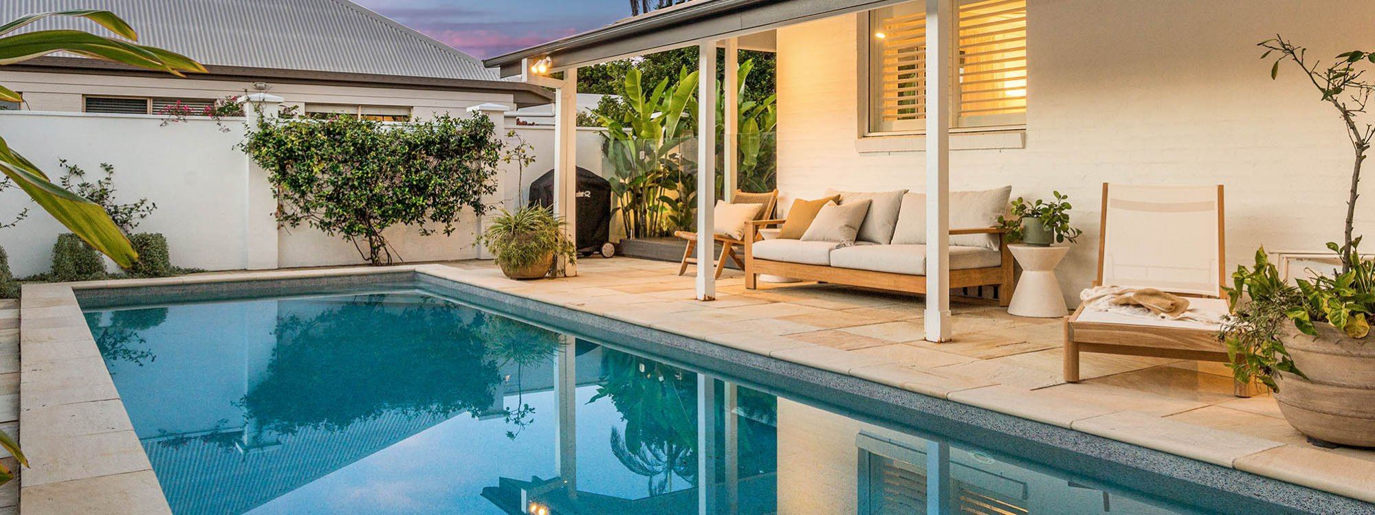 Shutters at Byron - Byron Bay - Pool and Outdoor Seating at Sunset